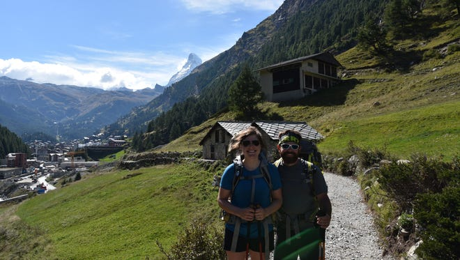 Wife and husband, Emily and Joe White, are two of three owners of Roads Rivers and Trails in Milford. The store is celebrating five years in business this fall. The Whites completed a 120-mile backpacking trek through the Swiss Alps this summer. They're picture here, in Zermatt, Switzerland, with the Matterhorn in the background.