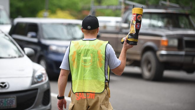 Salem firefighters collect donations during the 2015 Fill the Boot campaign to support the Muscular Dystrophy Association.