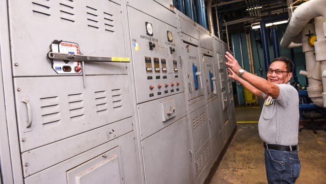 Electrician Supervisor Timoteo Ocampo points out the main electrical distribution panel still being utilized in the day-to-day operations at the Guam Memorial Hospital on Tuesday, Jan. 30, 2018. Ocampo says that the panel, installed when the hospital was built in 1974, manages 5,000 amps of current that allows the facility to operate. Plans to replace the unit has been designed but has yet to be implemented, he added.