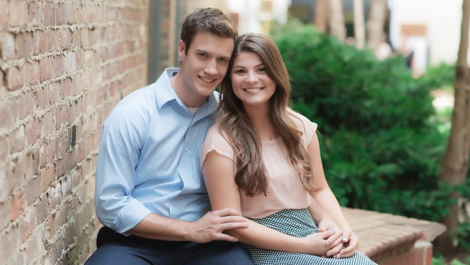 Bobby and Tori (Bates) Smith pose in a photo shoot in downtown Knoxville.