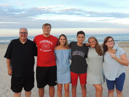 Pete and Carla Kramer flank their children, from left: Joe, Bridget, Jack and Claire, on their summer vacation in The Outer Banks. Fifty years ago, Pete's mother, a widow for one year, took her 9 kids through Europe in a Volkswagen mini-bus she learned to drive in the parking lot at Shannon Airport. They returned to Palisades in September, in time for back-to-school.