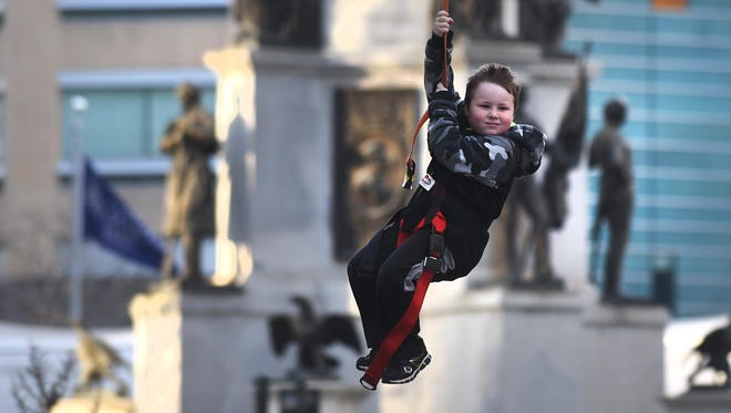 Brayden Temple, 6, of Canton, enjoys the zip line during the Meridian Winter Blast held at Campus Martius in 2018.