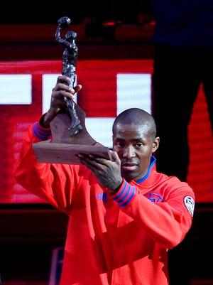 Los Angeles Clippers Jamal Crawford hoists his NBA Sixth Man Award.