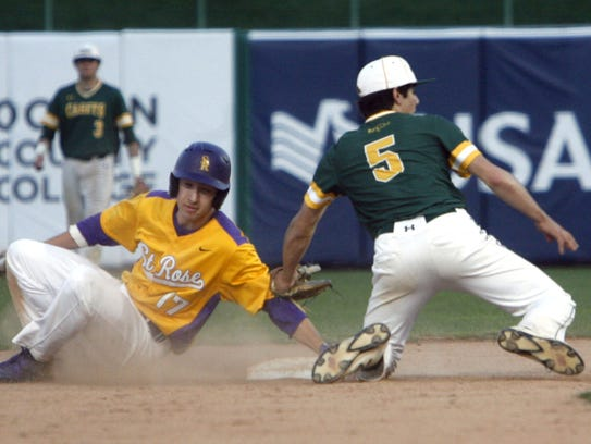 Riley Maypother of St. Rose slides safe into second