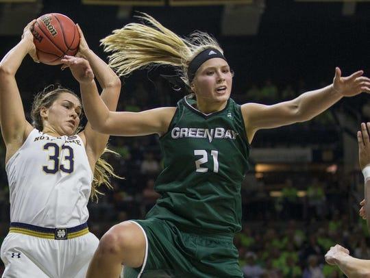 Notre Dame's Kathryn Westbeld (33) grabs a rebound