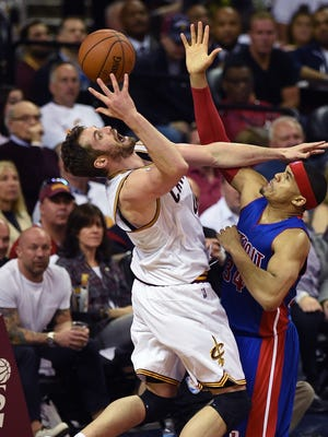 Pistons' Tobias Harris tries to defend the Cavs' Kevin Love.