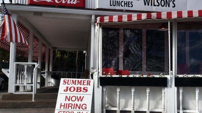 """Wilson's Restaurant & Ice Cream Parlor draws the attention of travelers on Wisconsin 42 in Ephraim. Owner Sarah Martin has taken the """"help wanted"""" sign down since this photo was taken in late May, but she says it's the first time in years she had to put it up."""