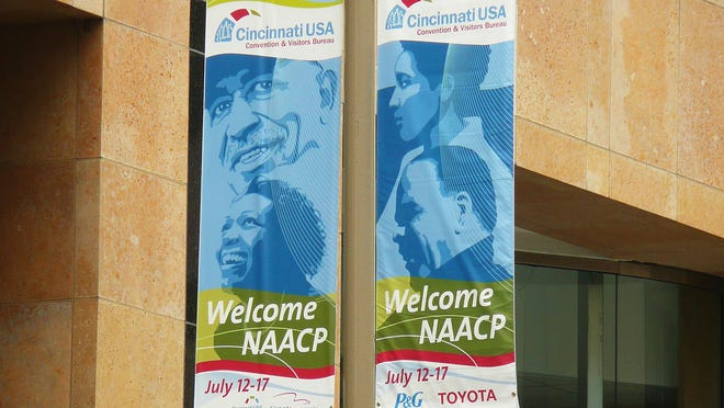 Banners welcomed the NAACP convention downtown in 2008. The civil rights organization is returning to Cincinnati in 2016, citing the city's vibrant downtown and Ohio's status as a presidential swing state.