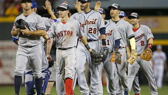 The American League team celebrates its 6-3 All-Star