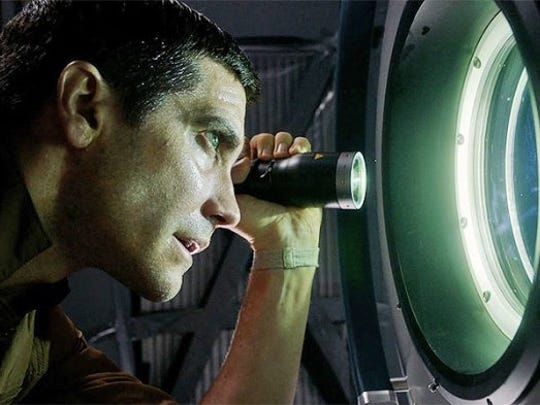 "Jake Gyllenhaal looks for things that go bump in the porthole in ""Life."""