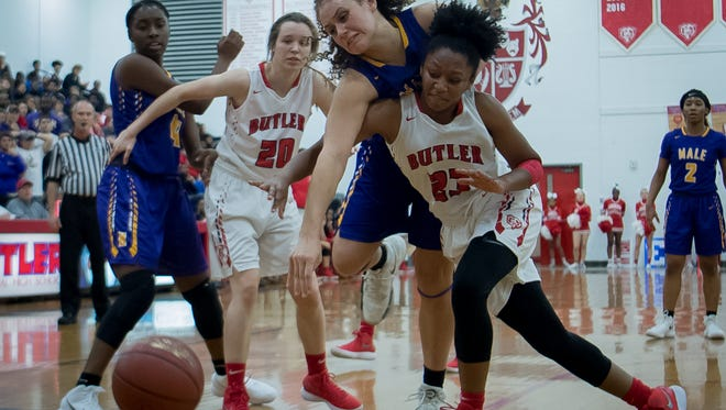 Butler's Jasmine Elder (23) and Male's Cameron Browning (34) collide during their game played at Butler High School in Louisville, Kentucky, Friday, December 15, 2017