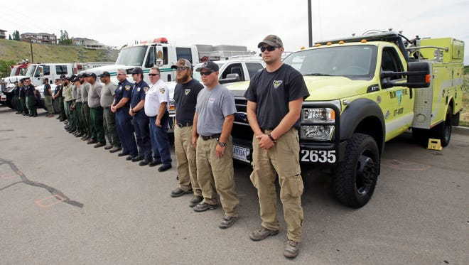 Wildfire crews look on after wildfire agencies laid out their preparation and expectation for the wildfire season in Utah Thursday, June 9, 2016, in Salt Lake City.