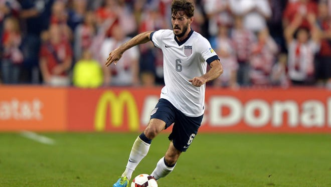 United States defender Brad Evans (6) brings the ball up field against Jamaica during the second half at Sporting Park.