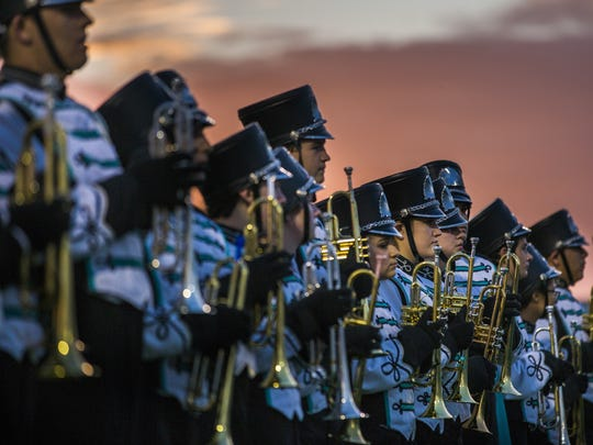 The Gulf Coast High School marching band files onto the field before the game against South Fort Myers on Friday, October 28, 2016 at Gulf Coast High School in Golden Gate.