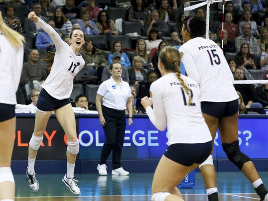 In this Dec. 20, 2014, file photo, Penn State's Megan Courtney (17) celebrates with teammates Micha Hancock (12) and Haleigh Washington (15) after scoring a point during the NCAA women's volleyball tournament championship match  against BYU in Oklahoma City. Penn State has won six of the last eight national championships.
