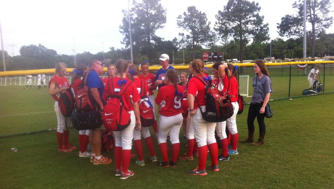 Macon-East Montgomery Academy coach Glynn Lott, left, talks to his team after a 3-2 win over Morgan on Friday.