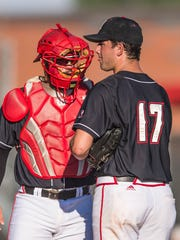 UL pitcher Gunner Leger (17) confers with Ragin' Cajuns catcher Handsome Monica during a series against Texas State last May.