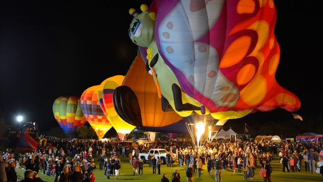 The balloon glow is a popular attraction at the Cave Creek Balloon Festival. Cave Creek Balloon Festival The balloon glow is a popular attraction at the Cave Creek Balloon Festival.