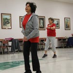 Being cheered on by her class, Margaret McClure,80, took on those 80 jumping jacks.