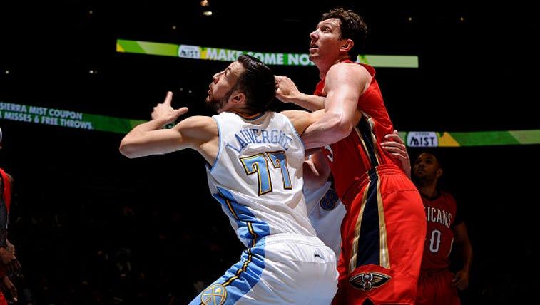 Omer Asik battles for a rebound against the Denver