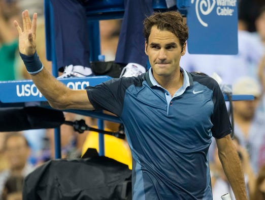 Roger Federer eased past Adrian Mannarino  on day six of the U.S. Open.