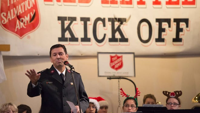 Salvation Army of Fort Collins Captain Isaias Braga speaks during the Red Kettle Kick Off ceremony at the organization's location on S. Mason Street on November 27, 2015.