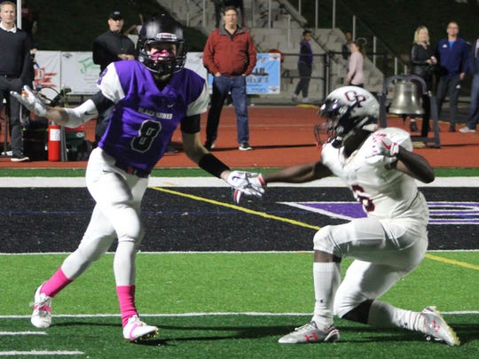 Bloomfield Hills receiver Darren Mack (8) looks for a call during action Friday night against Oak Park.