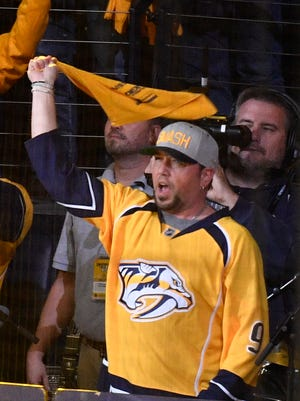 Country singer Jason Aldean waves a towel prior to Game 4 of the Stanley Cup Final at Bridgestone Arena on Monday, June 5, 2017.