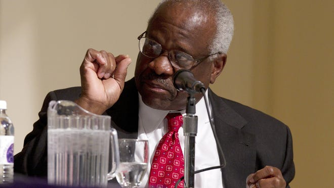 Supreme Court Justice Clarence Thomas speaks at College of the Holy Cross in Worcester, Mass., in 2012.