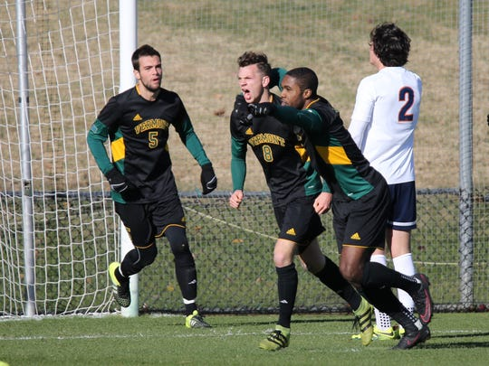 Vermont players celebrate the second half goal by Jon