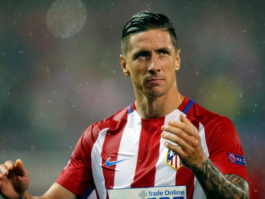 FILE - In this Wednesday, May 10, 2017 file photo, Atletico's Fernando Torres looks dejected at the end of a Champions League semifinal, 2nd leg soccer match between Atletico de Madrid and Real Madrid, in Madrid, Spain. Coach Diego Simeone, a longtime supporter of the Fernando Torres, said Wednesday Feb. 22, 2018, he will not go out of his way to try to keep Torres at Atletico going forward. (AP Photo/Daniel Ochoa de Olza, File)