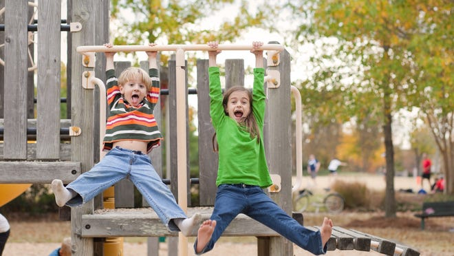 """""""Brother and sister, being silly and  having fun at the park."""""""