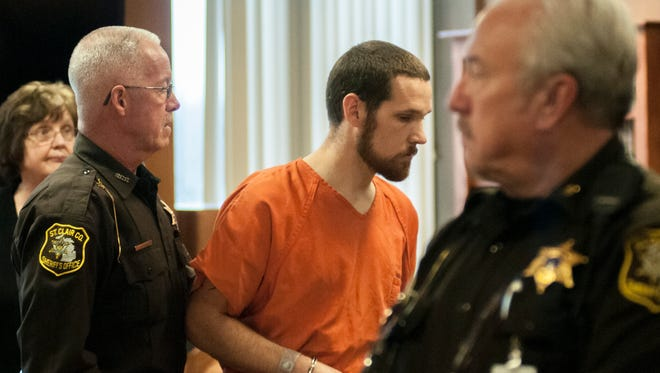 St. Clair County Sheriff's Deputy Tim O'Boyle leads Nathan Clark from District Judge Michael Hulewicz's courtroom Tuesday, Dec. 15, 2015. Clark, a former teacher of at-risk youth, pleaded guilty to criminal sexual conduct charges involving three boys.