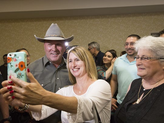 Clay Higgins takes a selfie with supporter Connie Chachere following a press conference announcing his candidacy May 18.