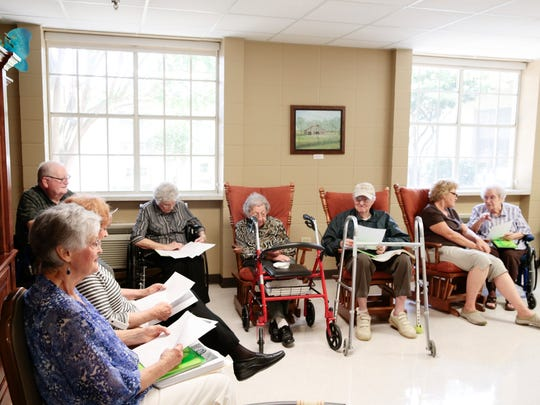 Nursing home residents follow Betty Roy and her sister, Mavis Fruge,at right, in a French vocabulary exercise in Arnaudville June 23, 2016.