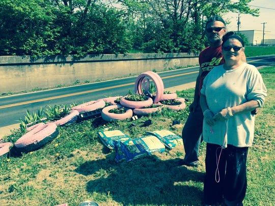 Jack and Jan Durnil are longtime Eastsiders who seek to beautify their neighborhood by collecting old tires and painting them pink in tribute to breast cancer sufferers.