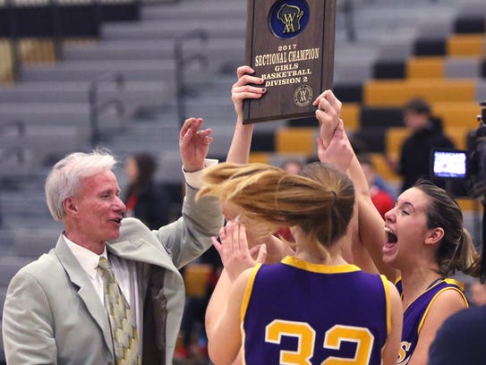 Coach Bob Maronde hands a WIAA Division 2 Sectional