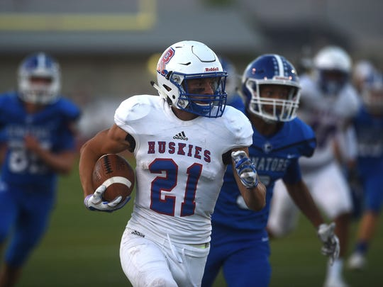 Reno's Evan Moore (21) runs for a first half touchdown while taking on Carson during their football game in Carson City on Sept. 1, 2017. Jason Bean/Reno Gazette-Journal- USA TODAY NETWORK