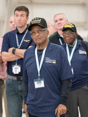 Korean War veteran Lewis Brown, from Charleston, SC, looks up at an aircraft on display as he and other veterans participating in JetBlue's Honor Our Heroes program take a tour of the National Naval Aviation Museum in Pensacola on Tuesday, November 7, 2017.  JetBlue's all-veteran flight crew flew approximately 150 fellow veterans from JFK airport to Pensacola for the day long visit at the Pensacola Naval Air Station.