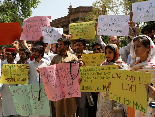 Pakistani students protest the killing of Mohammad