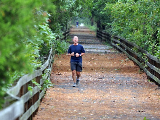 A man runs on the Breakwater Trail, which spans 3.6