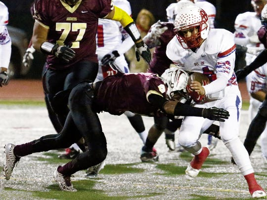 Andress safety Tristan Cooper, left, hauls down Bel Air receiver Omar Ballesteros during the 2014 season. Cooper, who will be a senior, is garnering attention from colleges and has offers from UTEP, New Mexico State, New Mexico and Texas State.