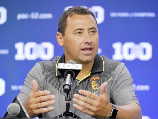 FILE - In this July 31, 2015, file photo, Southern California coach Steve Sarkisian speaks to reporters during NCAA college Pac-12 Football media days in Burbank, Calif. Sarkisian apologized Sunday, Aug. 23, 2015, for his behavior and inappropriate language at a team event Saturday. Sarkisian issued a written apology on the schoolís official website the morning after the Salute to Troy, a reception held before each season for the football team, alumni and athletic program donors, after several people who attended the event said on social media that the second-year Trojans coach appeared to be drunk while using profane language in praising his team.