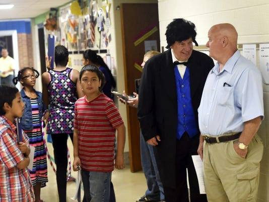 Gerry Reichard, right, portrays Thaddeus Stevens as he talks to Tommy Wauls, a student during the 1950s at Thaddeus Stevens Elementary School's 100th anniversary celebration Saturday.