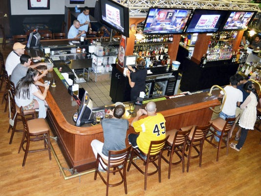 Guests at The Coliseum in Camp Hill can order food and drinks from the sports bar before bowling, playing pool or playing one of the complex's more than 100 arcade games.