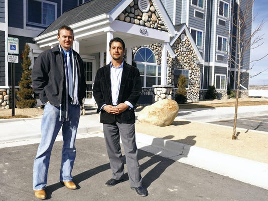 Aztec City Manager Joshua Ray, left, stands on Jan. 9 in front of the Aztec Microtel Inn & Suites with Sam Blue, president of Ace Development and owner of Dillon Industrial Park, where the hotel is located.