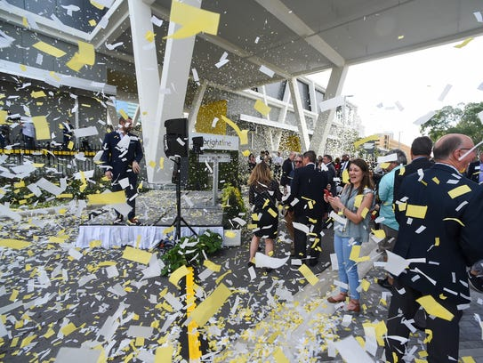 Confetti showers Brightline executives, elected officials