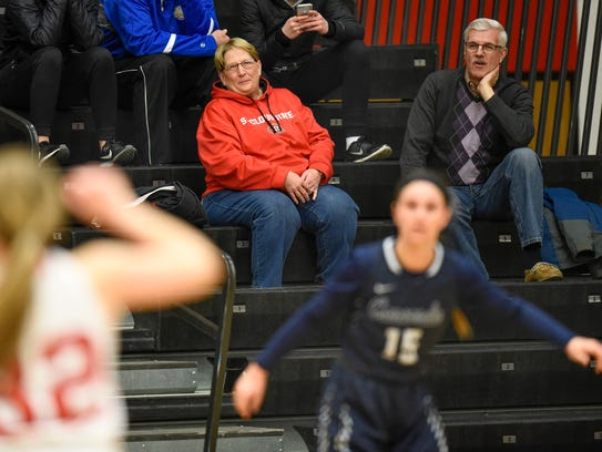 Dawn Schenk  watches the action on the court during