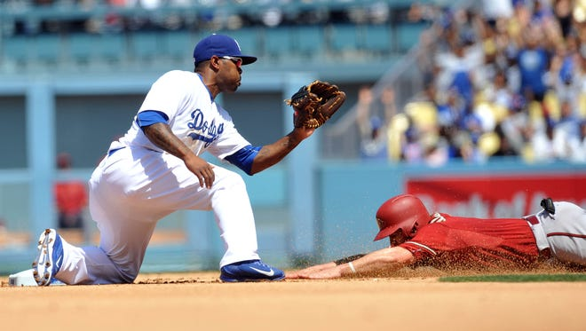 Arizona Diamondbacks catcher Tuffy Gosewisch (9) is caught stealing second in the fifth inning against the tag of Los Angeles Dodgers second baseman Howie Kendrick (47) at Dodger Stadium in Los Angeles on May 3, 2015.