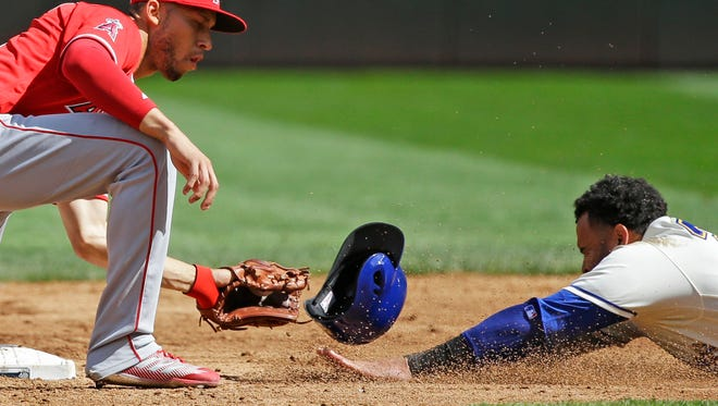 Seattle Mariners' Nelson Cruz, right, is out trying to steal second as Los Angeles Angels shortstop Andrelton Simmons, left, makes the pickoff catch and the tag in the third inning of a baseball game, Sunday, Sept. 10, 2017, in Seattle. (AP Photo/Ted S. Warren)